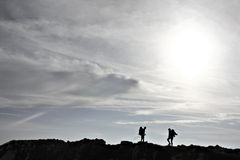 Hiker silhouette. Silhouette of two hikers on a mountain ridge Royalty Free Stock Photos