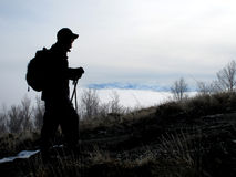 Hiker Silhouette. Silhouette of Hiker at the beginning of a hike Royalty Free Stock Image