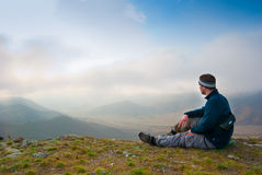 Hiker Sits On A Peak Stock Photography