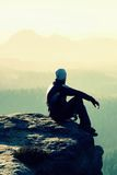 Hiker Sits On A Rocky Peak And Enjoy The Mountains Scenery Royalty Free Stock Photos