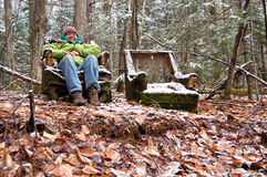 Hiker sitting in a broken chair Stock Photography