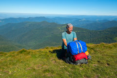 Hiker sitting on a mountain pass Stock Image