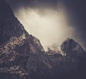 Hiker sitting on a mountain peak Stock Photography
