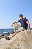 Hiker sitting on a rock Royalty Free Stock Photography