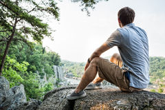 Hiker sitting on a rock Stock Image