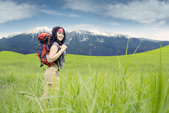 Hiker smiling at the camera in nature Stock Photo