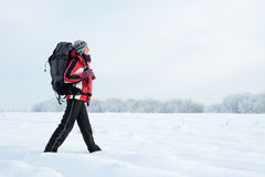 Hiker on the snow. Hiker on the winter snow field Royalty Free Stock Photography
