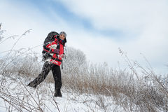 Hiker on the snow. On winter field Stock Image