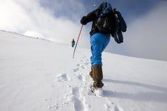 Hiker in snow Stock Photos