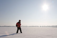 Hiker on the snow Royalty Free Stock Photo