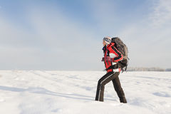 Hiker on the snow. On winter field Stock Images