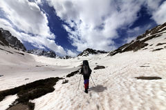 Hiker in snow mountain at sun day Royalty Free Stock Photos