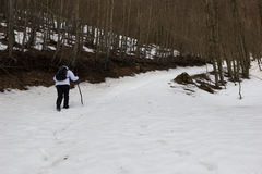 Hiker and snow Stock Images