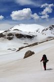 Hiker in snow mountains Stock Image