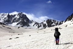 Hiker on snow plateau at spring mountain. Stock Image