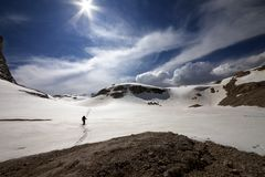 Hiker on snow plateau Royalty Free Stock Image