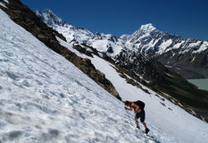 Hiker on snowfield Stock Photo