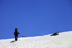 Hiker in snowy mountains at spring Stock Photos