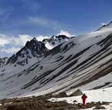 Hiker at snowy mountains in sun evening Royalty Free Stock Photography
