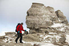 Hiker at Sphinx Of Busteni stock photos