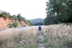 Hiker travelling near the river royalty free stock photos