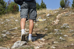 Hiker with sport shoes on mountain rocks path 2 Royalty Free Stock Images