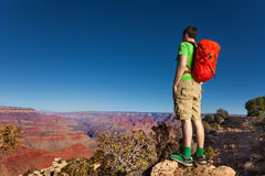 Hiker stand on the edge of Grand canyon Royalty Free Stock Photos