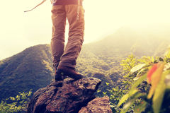 Hiker stand on mountain peak rock Royalty Free Stock Photography