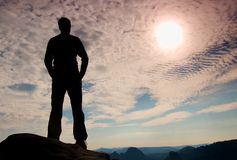 Hiker stand on the sharp corner of sandstone rock in rock empires park and watching over the misty and foggy morning valley to Sun Royalty Free Stock Image