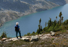 Hiker Standing Above Ring Lake. Male hiker standing above Ring Lake. Callaghan Valley. British Columbia Royalty Free Stock Photos