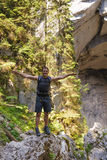 Hiker standing at a cave entrance Royalty Free Stock Images