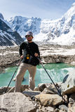 Hiker is standing at glacier lake Royalty Free Stock Photography