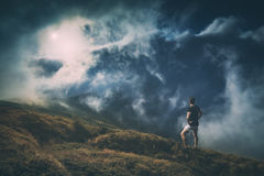 Hiker standing on a hill. Instagram stylization Royalty Free Stock Images