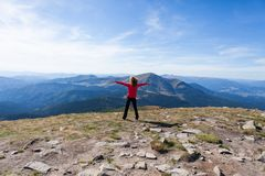 Hiker standing on mountain edge and looking to sky stock photos