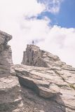 Hiker standing on mountain peak, toned image Royalty Free Stock Images