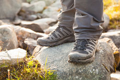 Hiker standing on rocks Stock Photos