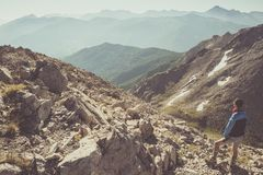 Hiker standing on rocky mountain footpath Royalty Free Stock Images