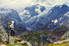 Hiker Standing On Rocky Mountain Hiking Outdoors Stock Photo