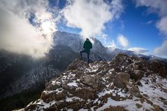 Hiker standing on the top of a hill in Tatra mountains. Poland Stock Photo