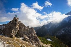 Hiker standing on the top of a hill in Tatra mountains Stock Image