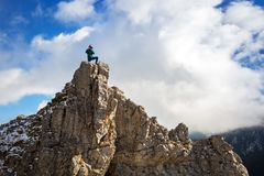 Hiker standing on the top of a hill in Tatra mountains Royalty Free Stock Photos