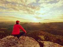 Hiker standing on top of a mountain and enjoying sunrise. Beautiful moment Stock Photos