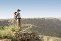Hiker Standing On Top Of Mountain Stock Photo