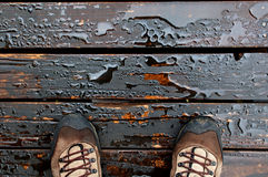 Hiker standing on a wet oily deck Royalty Free Stock Photo