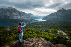 Hiker stands on top of the mountain Royalty Free Stock Images