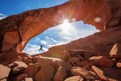 Hiker stay below Skyline arch in Arches National Park in Utah, USA.  Stock Photography