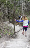 A Hiker Steadies Herself on a Steep Trail Stock Photos