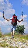 Hiker on stony footpath Stock Photography