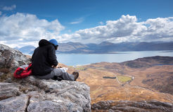 Hiker stops for lunch above Loch Linnhe Stock Image