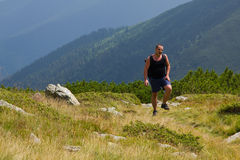 Hiker struggling to go on Stock Photography